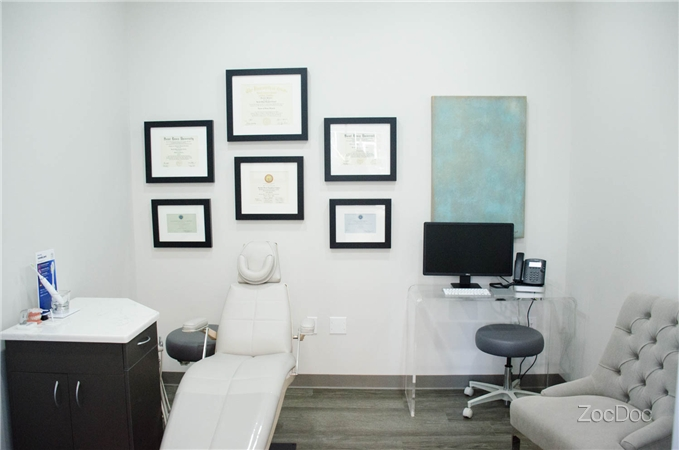 The quiet treatment room offers privacy for adult patients and new patient exams, and is contains Dr. Cooper's many orthodontic certificates and diplomas.