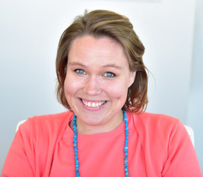 The smiling face of Ms. Ashley Taylor, our Financial Manager and Marketing Liaison.