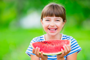 girl with braces and watermelon